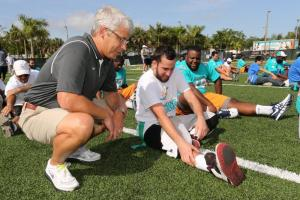 Miami Dolphins General Manager Dennis Hickey interacting with Special Olympics athletes