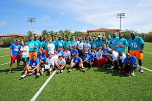 Miami Dolphins rookie class, General Manager Dennis Hickey and Special Olympics athletes group shot
