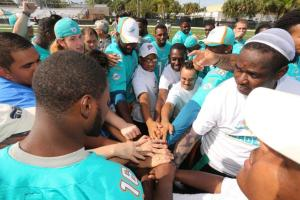 Miami Dolphins rookie class interacting with Special Olympics athletes
